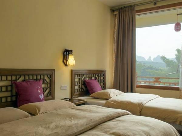 Snow Lion Riverside Resort - Exempel på rum