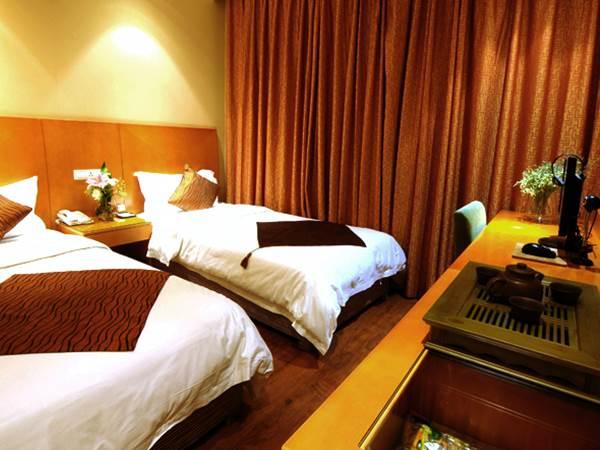 Taiji Business Hotel - Exempel på rum
